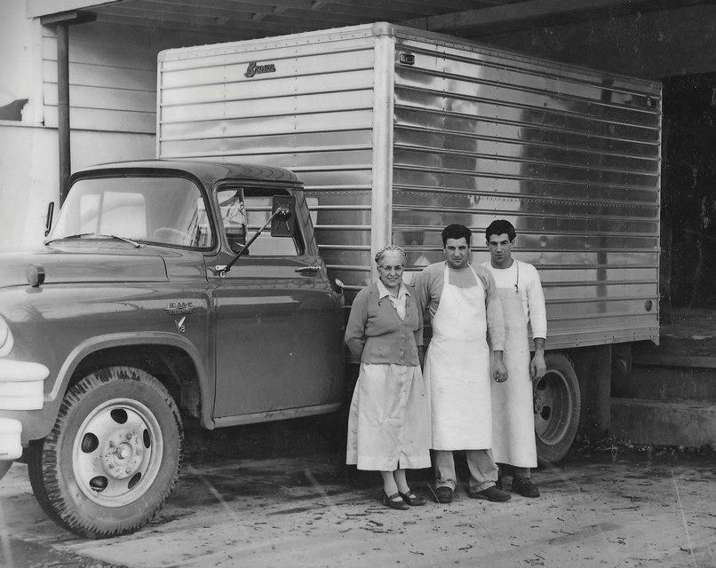 Rose Biggi and family members standing next to a delivery truck