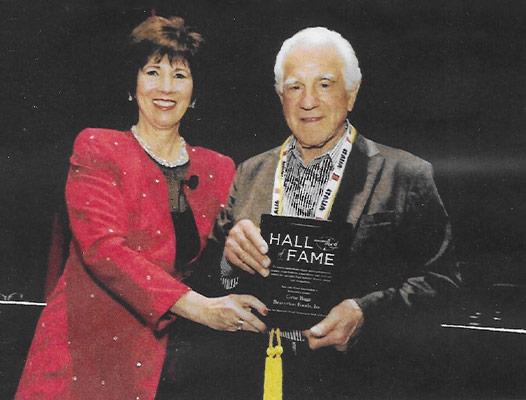 Geno Biggi accepting a Hall of Fame award