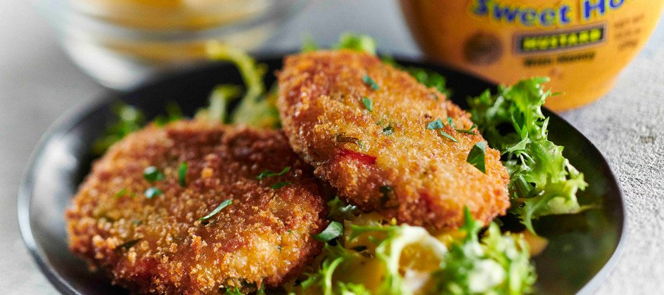 Crab cakes over salad with Inglehoffer Sweet Hot Mustard